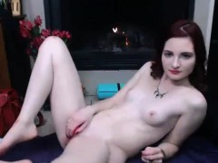 Amateur redhead camgirl with small tits posing on webcam