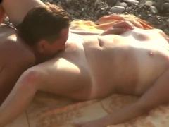 husband-cunnilingus-mature-wife-on-the-beach