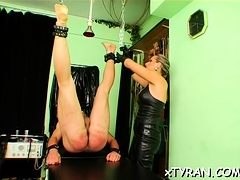Sexy bdsm festish with mistress thrashing her bondman hard