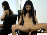Small tit Asian teen rides dildo on webcam