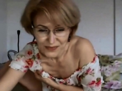 milf-in-glasses-spread-her-legs-and-shows-no-lips-pussy