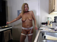 blonde mature bridget with monster boobs posing