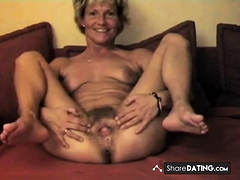 mature displays her lovely hairy twat