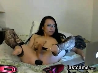 Asian Shemale With An Ass Toy