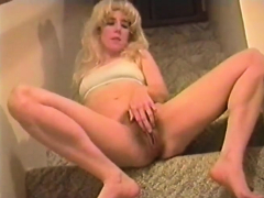 The staircase is her favorite spot to masturbate