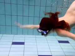 Big tits brunette Mia underwater naked