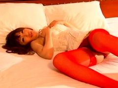 japanese-babe-gives-a-footjob-in-stockings