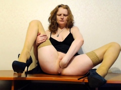 Seductive stepmom in stockings masturbates with a toy