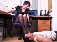 mature-mistress-and-her-foot-smelling-slave-in-home-office