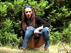 big-long-piss-in-the-grass-for-brunette-babe