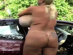 mature-with-big-boobs-masturbates-by-her-car-outside