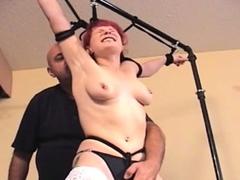 Succulent slut plays with her udders