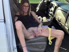 Skinny tattooed granny flashing her hairy pussy